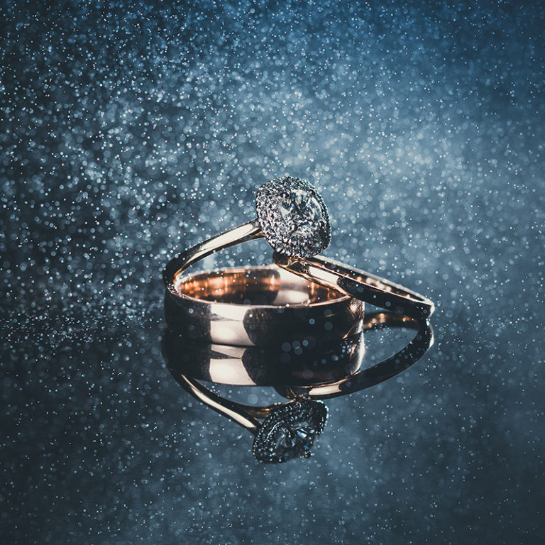 wedding rings reflections water